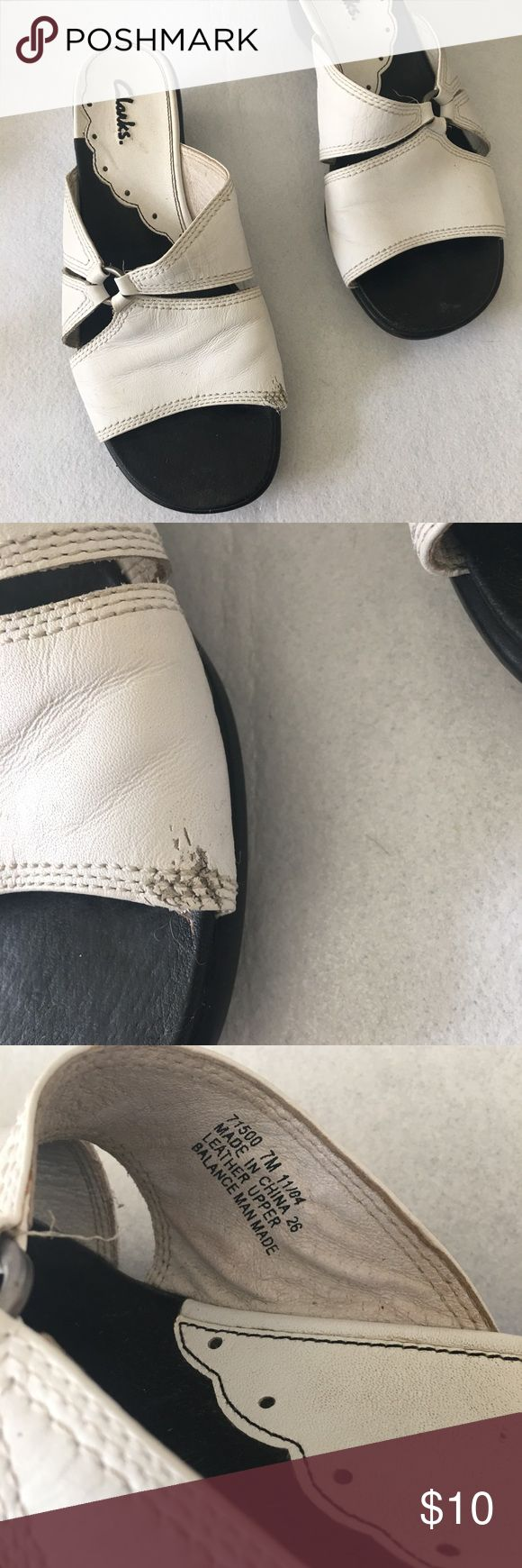 White leather Clark sandals White leather clark sandals great for any occasion. There are flaws in the shoes please check. Clarks Shoes Sandals
