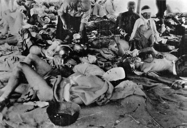 In this picture provided by Japan's Association of the Photographers of the Atomic (Bomb) Destruction of Hiroshima, nuclear bomb victims are sheltered at the Hiroshima Second Military Hospital's tent relief center at the banks of the Ota River in Hiroshima, Japan, 1,150-meters (1,258-yards) from the epicenter on Aug. 7, 1945, one day after the world's first nuclear bombing by the United States. (AP Photo/The Association of the Photographers of the Atomic (Bomb) Destruction of Hiroshima…