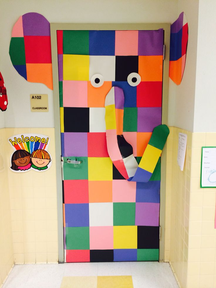 Elmer the elephant classroom door.  Cut 9x9 squares and piece together. I just used the cheap construction paper which worked out great because the colors were just like Elmer! This took about 2 hours to complete.