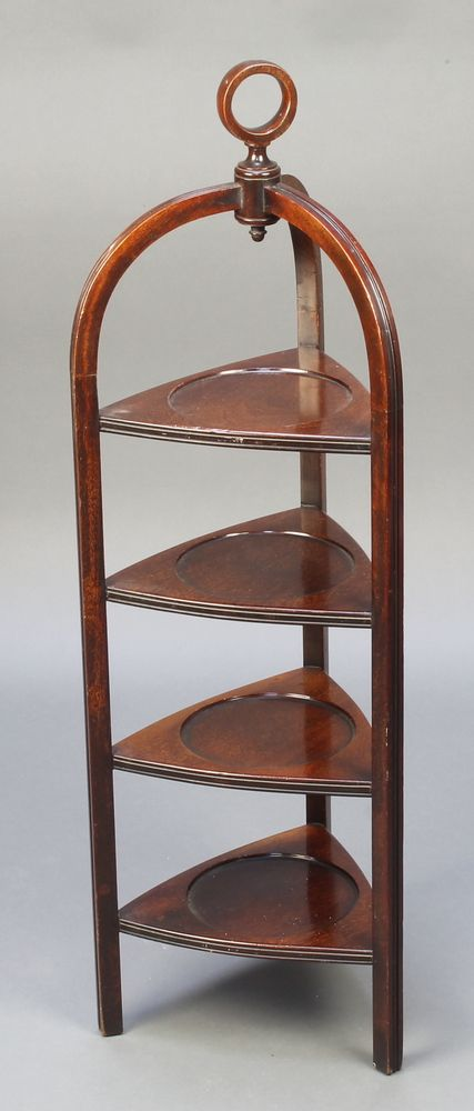 "Lot 922, An Edwardian triangular mahogany 4 tier cake stand with ring shaped handle 37""h x 10 1/2""w x 11 1/2""d est £50-100"