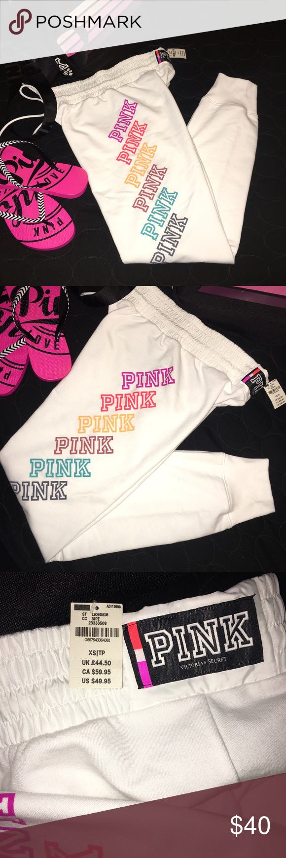 PINK Lounge/Gym Pant XS Get summer ready with these super cute PINK Victoria's Secret white joggers with multicolored PINK logo. Goes with a variety of tops, sports bras & swim. Brand New. Last pic is from another seller modeling her gym pant. PINK Victoria's Secret Pants Track Pants & Joggers