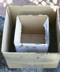 Make the form for the walls of a rectangular planter by centering a smaller box inside a larger one