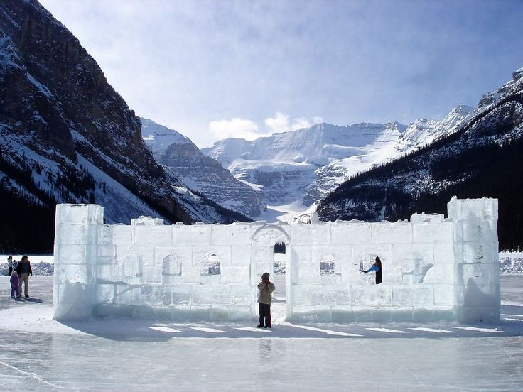 This is an ice castle that was built on a frozen Lake Louise in Banff National Park, Alberta, Canada. In the background is the Victoria Glacier. Stacy Conaway