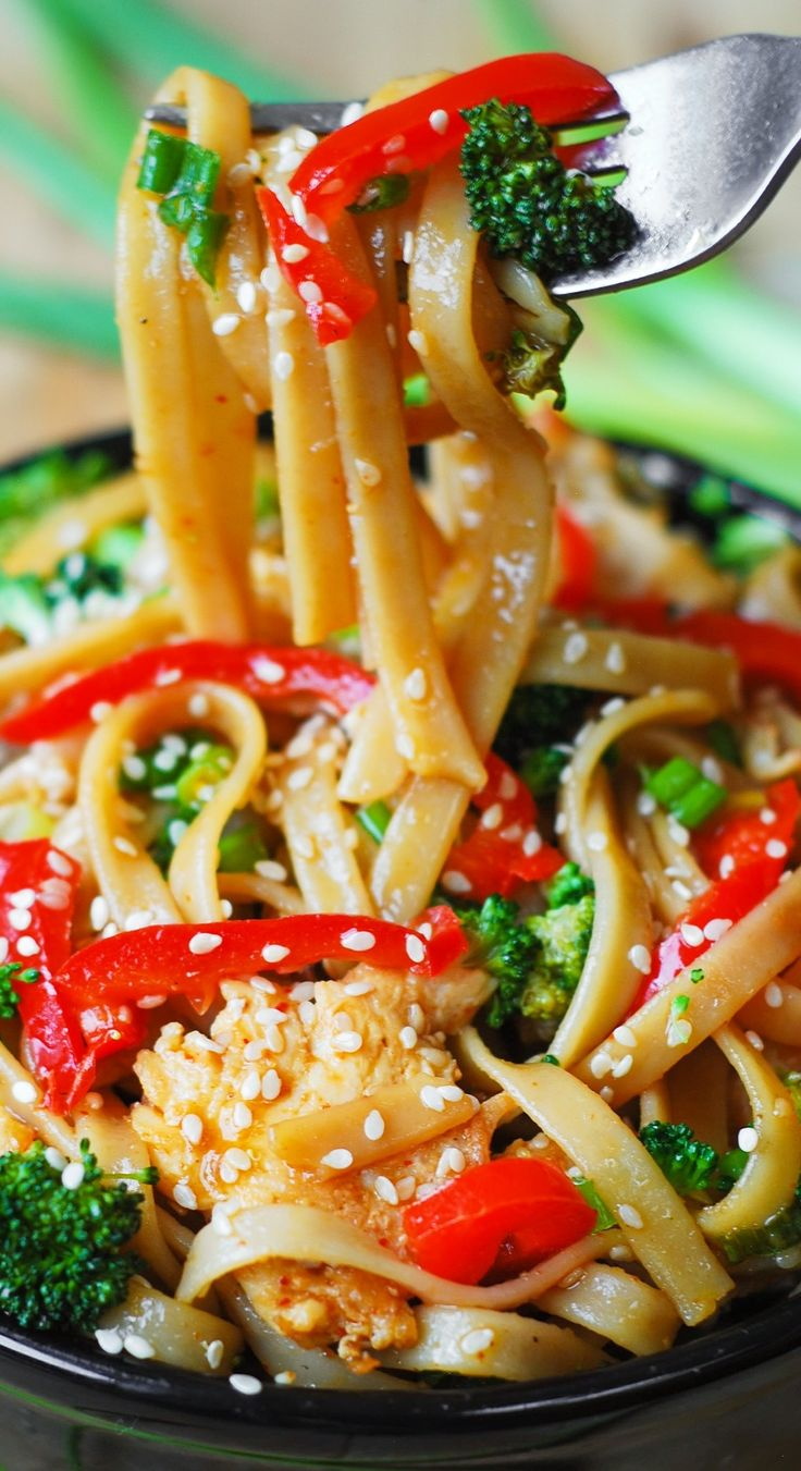 Asian Sesame Chicken & Noodles in a homemade Asian sauce – delish and easy-to-make! Thinly sliced bell peppers, blanched broccoli, grilled or seared chicken, toasted sesame seeds - YUM!