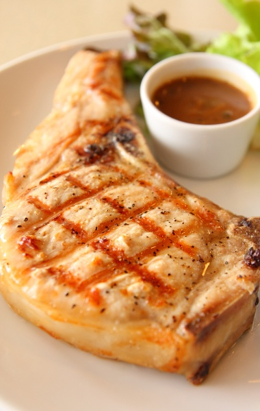Try out Michael Symon's grilled pork chop recipe! Very Simple but turnout is outstanding!