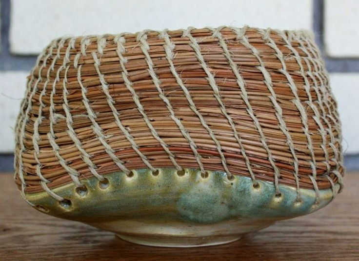 Pottery base with basket weave on top.