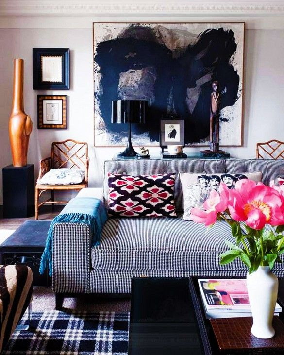 Gray and black living room with large-scale art and wood accents