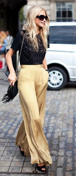 Poppy Delevingne - lace top and flowy gold pants