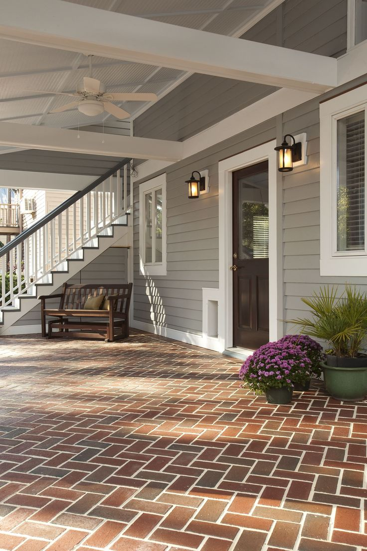 Beautiful back porch with herringbone brick pattern for Martin wade landscape architects