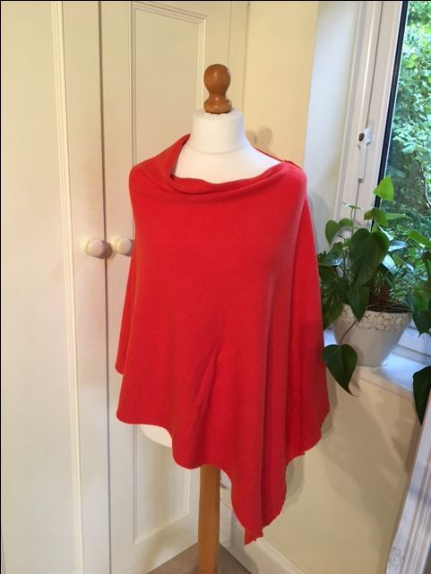 2 way poncho - Orange via Avenue 57. Click on the image to see more!