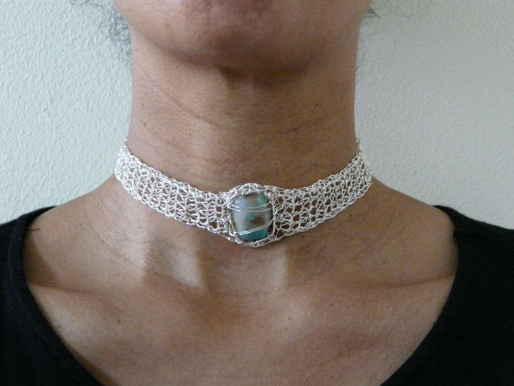 shocker made with silver plated wire (non tarnish) and a crystal gemstone in the middle. Crocheted and knitting item.