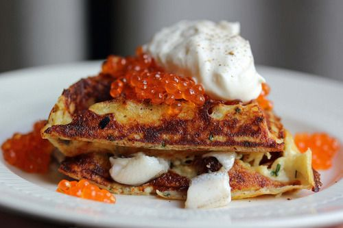 potato pancake waffles with pickled herring, creme fraiche, and salmon roe caviar