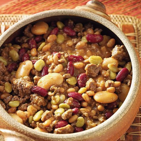 """Cowboy Calico Beans Recipe -This filling dish is a tradition at the table when my girlfriends and I go up North for a """"girl's weekend."""" The husbands and kids are left at home, but the slow cooker comes with us!—Julie Butsch, Hartland, Wisconsin"""