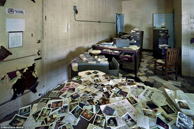 Unbelievable: The Highland Park police station is the most shocking of the portraits by Yves Marchand and Romain Meffre. Mugshots litter the floor    Read more: http://www.dailymail.co.uk/news/article