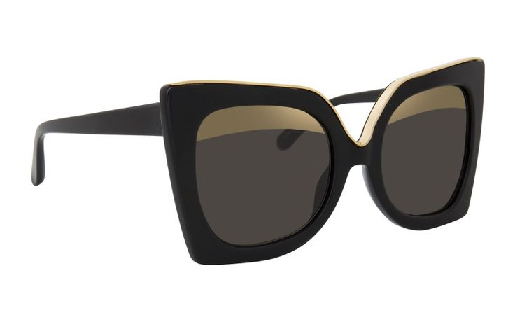 Nº21| Oversized statement sunglasses, featuring black pointy frames with gold details on their upper half.