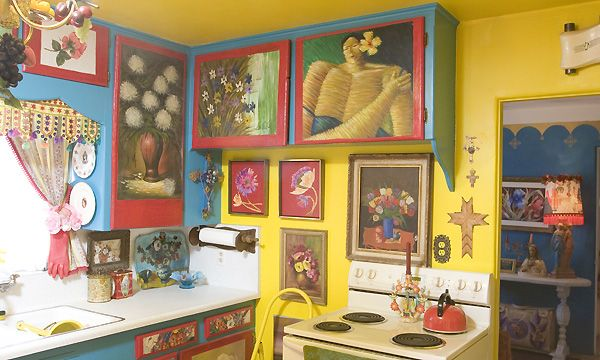 """DIY funky kitchen:  You don't need a lot of money, but you do need creativity in this kitchen, with oil paintings covering the painted whimsical cabinets."""