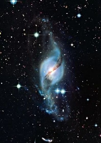 NGC 3718 also called Arp 214, is a galaxy located about 52 million light years from Earth in the constellation auras Major.  It has a warped s-shape. NGC3718 and it's companion NGC3729 are physically related members of the auras Major Galaxy Cluster.
