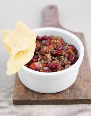 """""""Make a home-cooked meal, even if it's just a bowl of chili and a salad with garlic bread. There's nothing better than simple and delicious."""" —Lisa Fine, textile designer   - HouseBeautiful.com"""