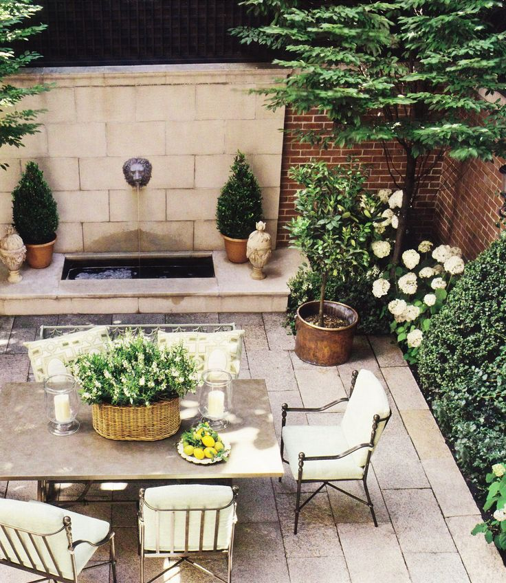 Green & white, brick & limestone courtyard