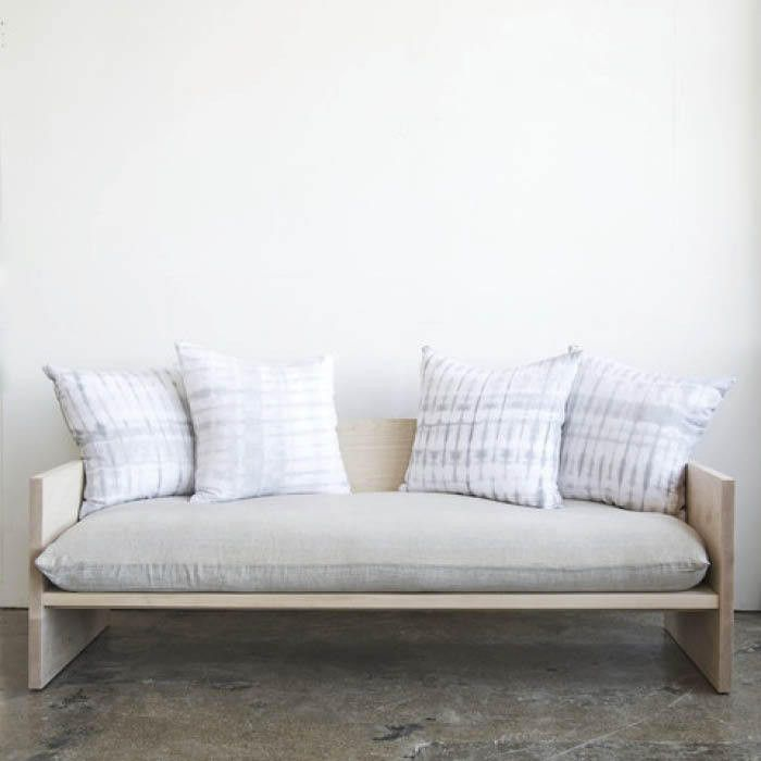 Farrah Sit's beautifully simple maple wood sofa decked out in Rebecca Atwood fabrics, now available via WorkOf.   Lonny