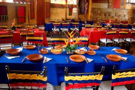 Colombia party- Love the chairs and set up of coordinated table cloths like the Colombia Flag.