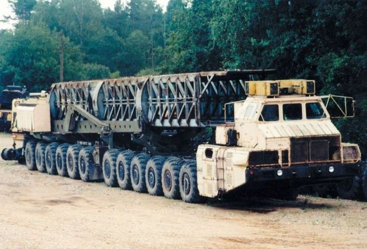 The MAZ-7907 ICBM TEL was the biggest wheeled vehicle ever built, but also one of the most impractical. To propell this behemoth it was fitted with two gas turbine engines producing 1250 HP, driving DC generators that powered electric traction motors on each of the twelve axles. This made for a very slow vehicle, so slow and heavy (150 tons weight limit) that the road mobile RT-23 Molodets ICBM it was intended to carry was even more vulnerable than the static silo version.