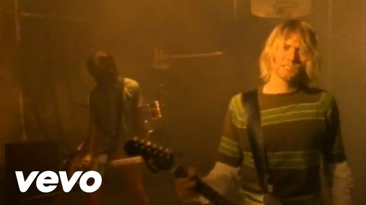 Nirvana - Smells Like Teen Spirit (1991) 90s rock band Nirvana pioneered the Grunge look of the 1990s.   Grunge can be described as a comfortable, slouchy style of dress that includes clothing items such as ripped jeans, flannel shirts, and combat boots....often accompanied with messy hair.