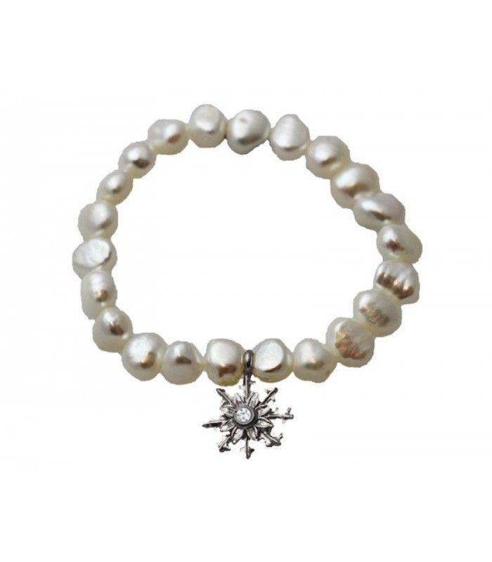 Pulsera Eguzkilore de perlas de agua dulce, con pieza central de Eguzkilore de plata, con una circonita blanca en el centro. Pulsera elástica.