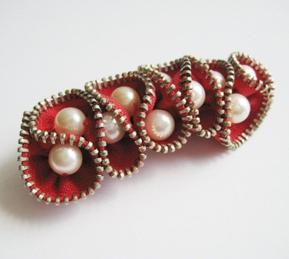 red pearl zipper brooch.  How to make Zipper Brooches: Excellent tutorial at www.finercraftguild.com/zipper-jewelry/ by mandy