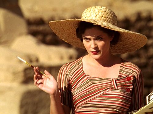 Jackie of Agatha Christie's 'Death on the Nile'. Wicked and stylish. Killer red lips.