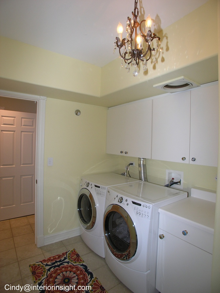 cute utility laundry room room with light fixture