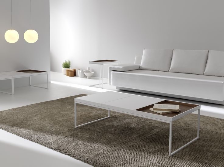 | TRAY - Designed by: Antoni Arola | Tray is a collection of coffee tables with lots of modern, functional appeal. A metal structure serves as a support to a series of mobile trays that can be given various combined finishes.