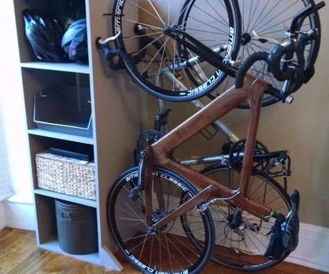 My wife and I have two road bikes, and no garage in our small city apartment, so I have been thinking about the best way to store them inside. Because we want to get our security deposit back at the end of our lease, we are cautious about putting hooks into the walls, and we don't want our bikes just laying around. I thought the best solution would be to build some kind of freestanding bike rack. My wife had the idea to incorporate it into a bookshelf so that we would get more storage s...
