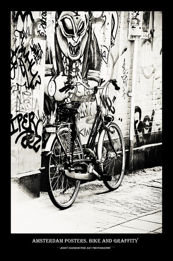Amsterdam Posters. Bike And Graffiti by Jenny Rainbow.  Big collection of Amsterdam posters with black framing with concept of city architecture and street photos. This collection offering the same style for all the images and perfectly suits for wall decor of the bars and restaurants or minimalistic home interiors.