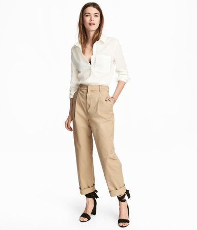 Beige. Wide-cut, loose-fit chinos in woven cotton fabric. Pleats at top, zip fly, hook-and-eye fastener, side pockets, and welt back pockets.