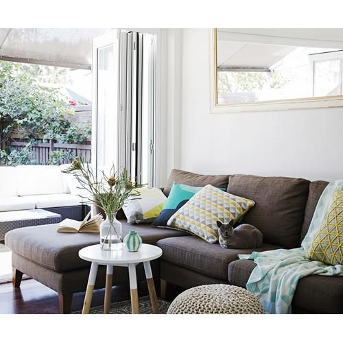 See how stylist Kerrie-Ann Jones makes over a Sydney family's rental home with a budget of just $1000.