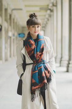 A blanket scarf adds plenty of warmth and interest however it can cause shape to be lost under all the layers. Try a thin belt to keep it all together and define the waist. A monochrome outfit also helps with slimming the figure behind the scarf detail.  Photo credit- Pinterest