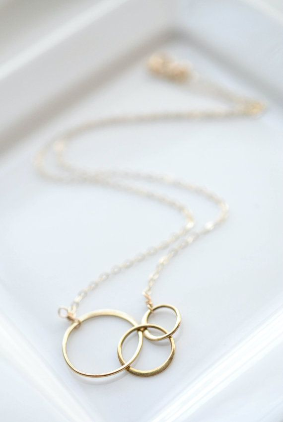 Gold Circle Necklace for any occasion. Three interlocking 14k gold fill rings are a constant reminder that we are all connected in one form or another. Beautiful piece of Interlocking Circles Jewelry.
