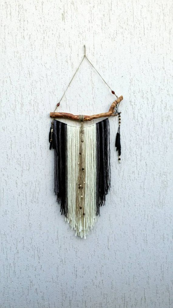 This unusual bohemian wall decoration dream catcher type will be a great addition to any free spirit home that loves boho gypsy style. Made from natural materials such as: forest pine tree root, wool in earthy colors (cream, black, grey), twine rope, wooden and glass beads and black feathers. The multi curved tree root has been dried for a long time, cleaned and varnished. Measurements are as follows: Width of the root: 20 inches - 51 cm Longest hanging yarn (from top of root): 33 inches…