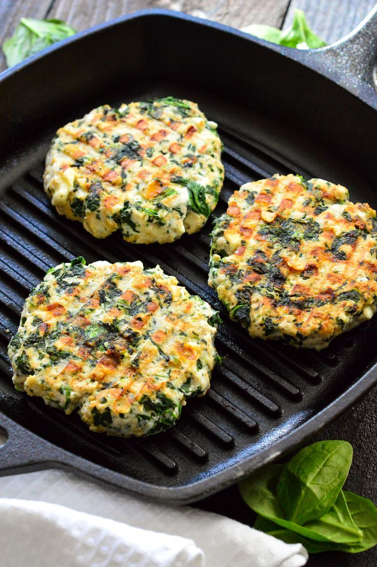These LEAN juicy spinach feta turkey burgers are loaded with oats, spinach, egg whites, and feta cheese.