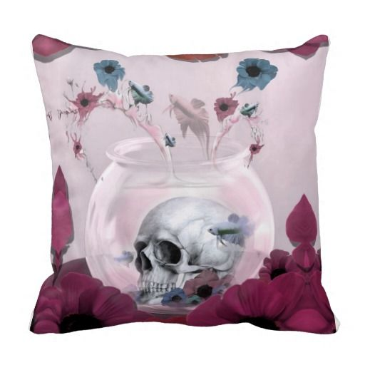 Pink skull in fishbowl with poppies