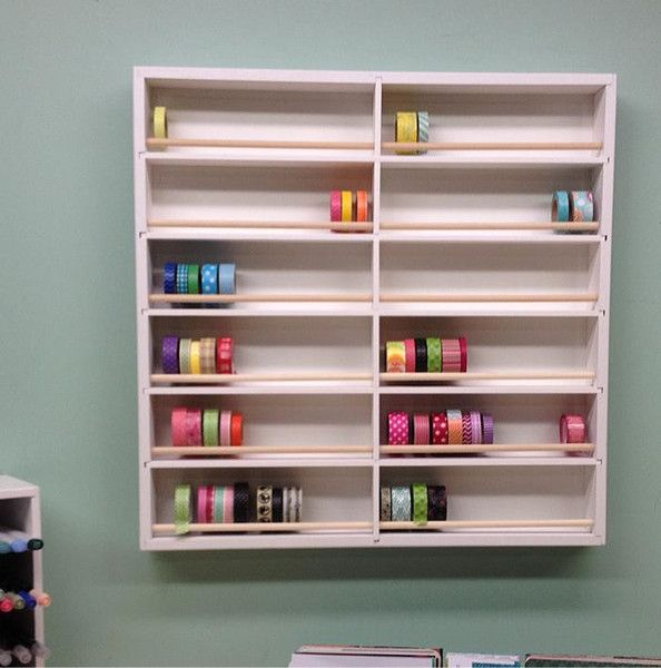 A front view of the Washi Tape Organizer hanging on the wall as if it would in a craft room.