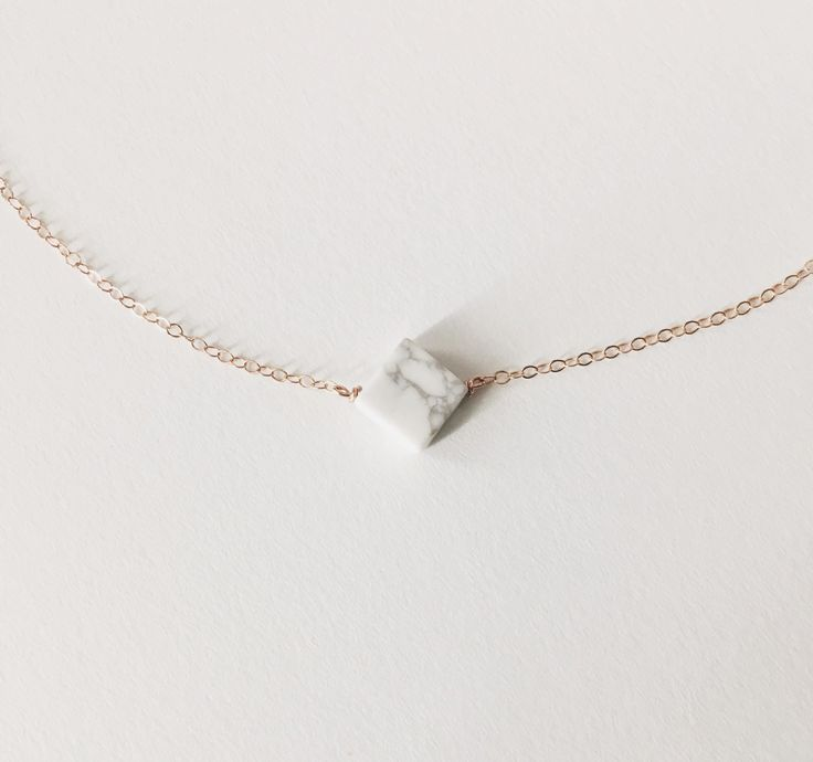 I am loving the white marble trend right now. Simple, beautiful and unique! Perfect for bridesmaids gifts! Details: - Howlite diamond bead measures 8mmx8mm - chain measures 1.3mm in thickness. - chain available in 14k rose gold, 14k gold, & sterling silver -ALLERGY INFORMATION- Your piece of jewelry will come packaged in a kraft box, using eucalyptus or lavender as decoration. Please message me and let me know if you have an allergy to either.   IMPORTANT SHIPPING & PROCESSING INFO: I will…