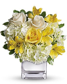 Sweetest Sunrise Bouquet-Even if she's already in a great mood, this cheerfully charming bouquet will boost her spirits to the sky. Yellow roses, crème roses and other favorites in a sleek silver cube vase - irresistible! The bright bouquet includes white hydrangea, light yellow roses, crème roses and yellow alstroemeria accented with fresh greenery. #CarlsonWildwoodFlorist #LargoFlowers #GetWellFlowers