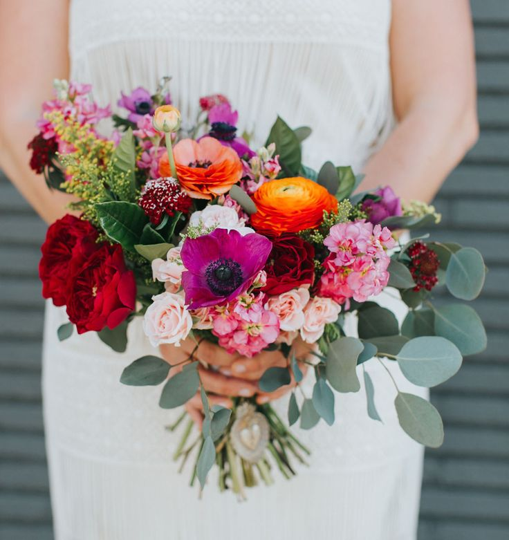 Vibrant colorful bouquet with poppies and pops of magenta, crimson, orange and pink