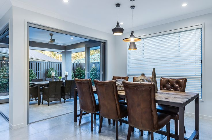 #Diningroom #ideas from #Ausbuild's  Ellison #display #home. www.ausbuild.com.au. Become immersed in this #vintage inspired home, with toffee #leather #chairs and an aged #wooden #table.