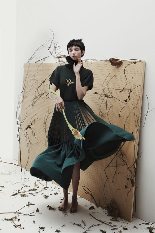 WORK FOR RCA STUDENT E WHA LIM- CREATING ARTWORK AND STITCHING ONTO WOOD AND KNIT FOR KNITWEAR PIECES