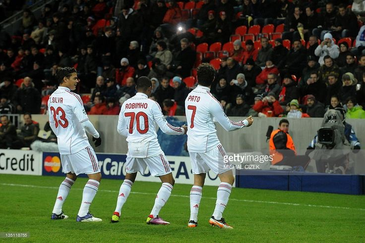 AC Milan's Pato (R) celebrates with his teammates Thiago Silva (L) and Robinho after scoring during the UEFA Champions League, Group H, football match between Viktoria Plzen and AC Milan in Prague on December 6, 2011.
