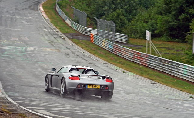 Porsche Carrera GT on a wet Nordschleife by Martijn Kapper, via Flickr