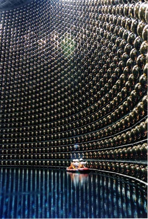 """Claustrophobic inner tubing -- """"Kamioka Mozumi mine in Japan - 1,000m underground. Clever people built the machine to detect neutrinos, proton decay and cosmic rays.  This is done using the 12,000-ish photomultiplier tubes (extremely sensitive light detectors) visible on all walls of the 'ultra-purified water-filled' tank."""""""